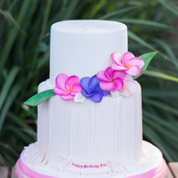 Luau Birthday Cake Luau birthday cake featuring vibrant plumeria flowers in pinks and purple. Special thank you to Cakes by Joanne Charmand for allowing me to...