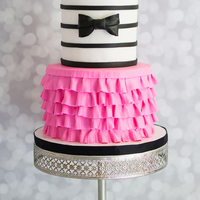 Tutu Or Bow Tie Gender Reveal Cake Design based on a cake by Sweet Scene Cakes