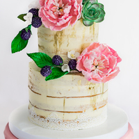 Semi Naked Ganached Wedding Cake Rustic meets glam with semi naked gold flecked ganache, peonies, succulents and blackberries.