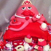 Diva Octopus  Diva's night out cake consists of red velvet cake, cream cheese frosting, and covered in fondant. Diva is sitting pretty on her red...