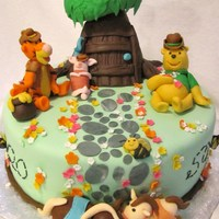 Cowboy Winnie The Pooh Themed Cake This was made for a birthday party for two different people one who loves Winnie the Pooh and the other that loves horses. Figures all made...