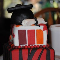 Mohawk Grad Third two teir cake with fondant! grad for my girlfriend, with her school logo.