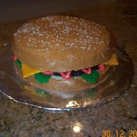 Cheeseburger! vanilla cake, chocolate frosting, textured marzipan ring for hambuger meat, marzipan cheese, fondant lettuce