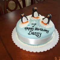 Penguin Birthday Cake Fondant covered chocolate cake, with fondant penguins on small ice floes