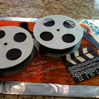"Film Reel Cake Gum paste and fondant decorated film reel cake. The fondant rainbow picture and ""from the desk of"" were elements that had special..."