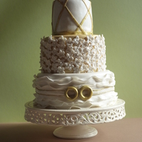 50E Wedding Aniversity White And Golden Cake   een white with golden cakeFor a couple that has been married for 50 years.