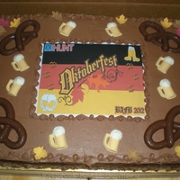 Oktoberfest Celebration Cake Full Sheet, 3 layers of chocolate and vanilla (black, red, gold). Covered with chocolate buttercream and decorated with an edible image,...