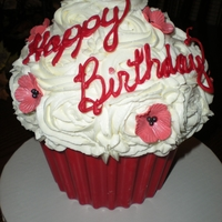 Giant Birthday Cupcake Giant cupcake, red velvet cake with cream cheese filling, shell was molded from colored chocolate, covered with buttercream icing, topped...