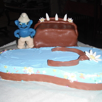 Smurf, Sandal Strawberry Cake.   Sugar Smurf, sandal strawberry cake.