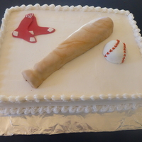 Red Sox buttercream with fondant decorations, baseball bat and ball are cake too