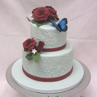 Two Tier Butterfly Cake This color scheme worked out better than I expected. Covering the cakes in fondant was absolutely awful because the kitchen was so hot, the...