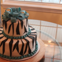 Zebra Cake With Turquoise Accents  WASC cake with faux fondant buttercream filling and outside icing. Fondant bow and accents. I made this for my friend's bday. This is...