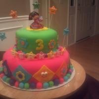 Dora The Explorer Cake Double 10 in and 6 in rounds topped with MMF and filled with buttercream
