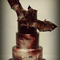 Bat Creature Cake Made for my nephew's birthday, and inspired by the movie Dracula Untold. The bat creature is modeling chocolate and fondant over a...