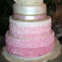 Buttercream Umbre Ruffled Wedding Cake Only the third tier is fondant covered. The rest of this cake is buttercream and made this for a friend. She loved it and it was perfect...
