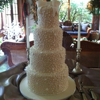 4 Tier Ivory Piped   4 tiers of red velvet covered in ivory fondant and piped all over
