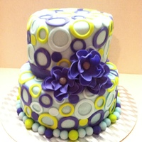 Lots Of Circles   Made this for my cousins daughter who was turning 12. The colors are purple, lime, and light blue. All fondant.