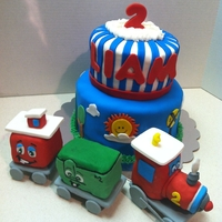 Two Two Train  Train cake for my little boy to match the Two Two Train party. The train cars are made out of cereal treats and turned out a little big so...