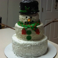 Snowman   8, 6, 4 inch tier cake. Buttercream with fondant accents.