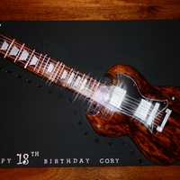 Gibson Guitar This is a Gibson SG Guitar - Choc mud and raspberry filling