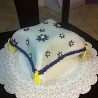 Pillow Cake chocolate cake, tassles are royal icing and borfer and flowers are buttercream