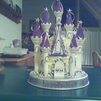 Princess Castle Cake cake is iced with buttercream, flowers are fondant. can you find tinkerbell?