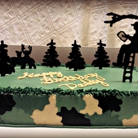 Hunting Birthday Cake Buttercream Icing. Silhouettes are chocolate transfers. Hunter is holding an Ipad per customers request.