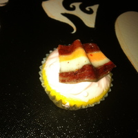 Bacon Cupcake This cupcake was made for something called porkfest. I made fondant look like bacon with strips of fandant and then i hand painted the...