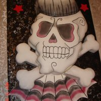 Skull Cake 1/2 sheet rockabilly cake I did for my nephews 30th birthday! Did from photo my niece sent to me. Was a big hit.