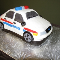 Police Car Birthday Cake Birthday cake I made for my brother (he's a police officer) - used a car cake pan and decorated with MMF
