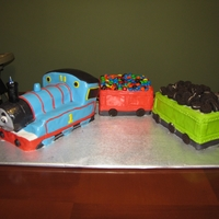 Thomas The Train Thomas the Train cake for my 1 year old's birthday - Thomas is all cake but the other parts are rice krispie treats as we did not need...