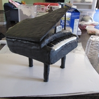 Piano Grand piano - MM Fondant covered cake...please excuse the wrinkles as this cake almost ended up on the floor just before I took this pic...