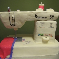 Kenmore Sewing Machine Sewing machine for my mother's birthday. The top portion is rice krispie treats and the remaining is all cake and MMF.
