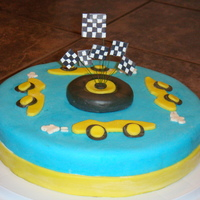 "Racecar Cake Sour cream chocolate cake covered with dark chocolate ganache and fondant. This was made for my son ""just because""!"