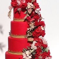 Prosperity   Red Fondant Tiers with Red and Pink HandmadeGumpaste Flowers andGold Ribbon