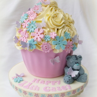 Tatty Teddy Themed Giant Cupcake Vanilla flavoured giant cupcake. The colour scheme was mainly chosen to match the pretty ribbon. Love the pink and blue combination. :) x