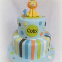 "Lion Themed 1St Birthday Cake This is a 5"" and 7"" cake based on the customer's party invitations."