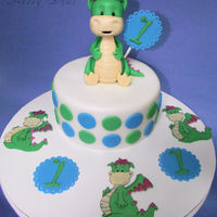 Dragon Cake Small dragon cake with fondant dragon and dragon cupcake toppers.