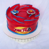 Beyblade Cake I still have no idea what beyblade is so I felt like i was working in the dark on this cake. My friend gave me a pic to go by but the rest...
