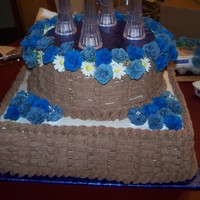 Basket Weave Chocolate Cake This cake is marbled with melted chocolate and vanilla cake. It has gum past roses in cornflower and royal blue.