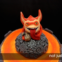 Skylanders Cake Featuring Trigger Happy  This cake was really really fun to make. Alex's mother came to me with a unique idea for her son's birthday. I called it unique...