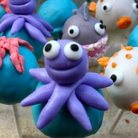 Under The Sea Cake Pops Vanilla w/ cream cheese icing cake pops for a two year old's birthday. It was under the sea themed. Decorations are fondant and royal...