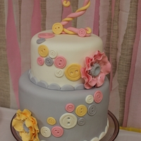 Second Birthday Cute as button theme in yellow, pink, grey and white. Inside is alternating chocolate and vanilla layers with chocolate gangache and...