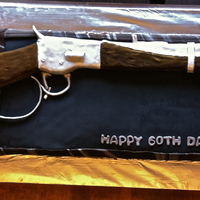 Rifleman Cake This was a Rifleman themed cake for a 60th birthday. The cake is chocolate covered in fondant and the rifle is RKT covered in gumpaste. The...