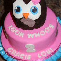 Owl Cake Vanilla cake (tinted pink) with swiss meringue buttercream covered in Fondant. Some decorations are gumpaste.
