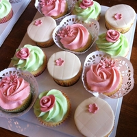 Pink And Green Cupcakes Green icing is apple, pink is pomegranate and the lace surrounds are from dollar store doilies.