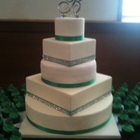 Irish Bling 5 tier round/square wedding cake for my daughter. The cake was white chocolate alternated with dark chocolate espresso and filled with dark...