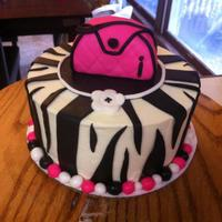 Zebra Print With Purse My first zebra print. Had much fun making the purse! Cake was 3 layers of pink velvet, filled and iced in vanilla buttercream with mm...