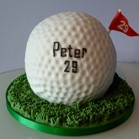Giant Golf Ball Cake I was asked to create a giant golf ball cake for an avid golf fan. The cake is a chocolate cake, covered in white icing / fondant. The...