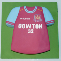 West Ham Football Shirt Cake I was asked to create a West Ham football Shirt cake for a man who was 32. The cake was carved out of a 12 inch square cake and is placed...